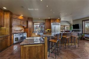 Gourmet kitchens boasts granite countertops, hickory cabinets, tile flooring.